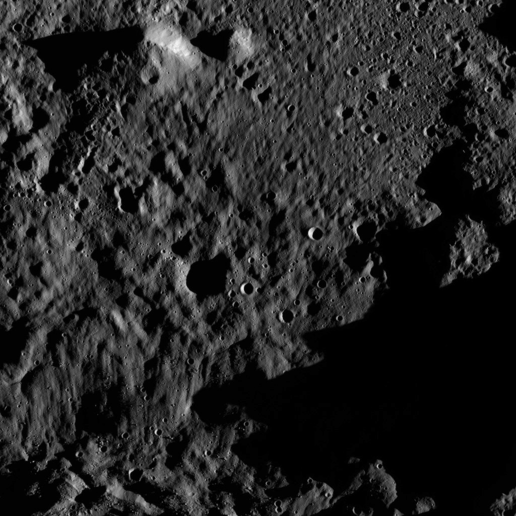 This view, taken on June 3, 2016, from NASA's Dawn spacecraft shows an area within the floor of the Mondamin impact basin, which lies in the southern hemisphere of Ceres. Mondamin Crater is about 78 miles (126 kilometers) in diameter.
