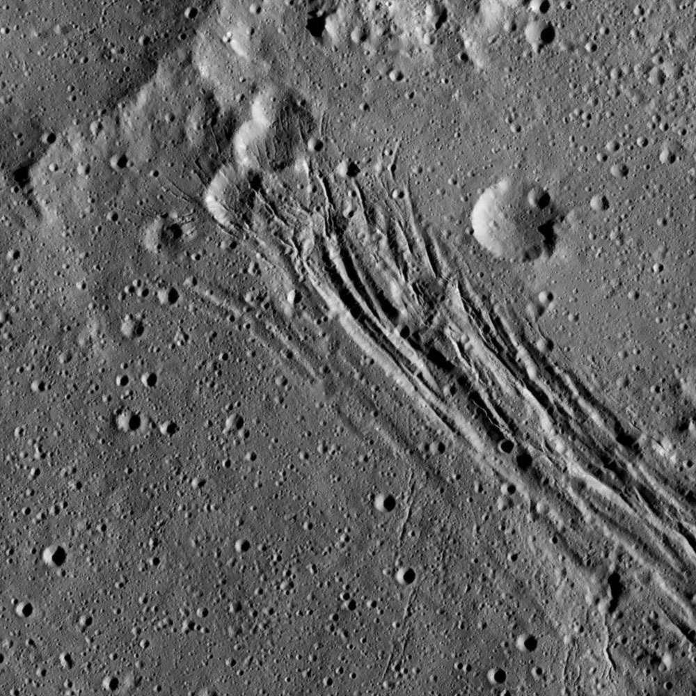 This image, taken by NASA's Dawn spacecraft, shows a series of linear features, which are depressions that located within the large Yalode Crater on Ceres.
