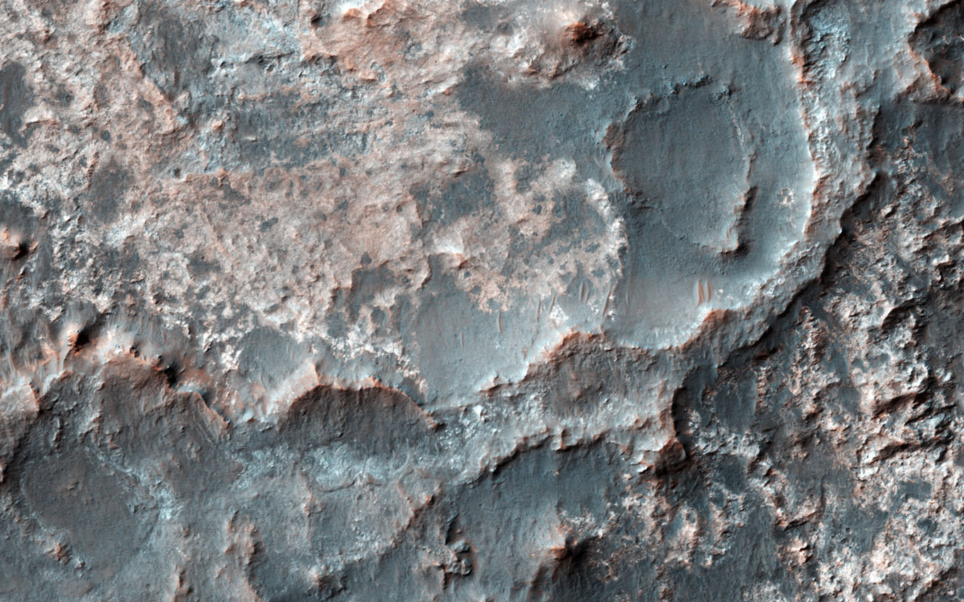 This image captured by NASA's Mars Reconnaissance Orbiter shows a transition from depressed to inverted channels in the Gorgonum Basin.