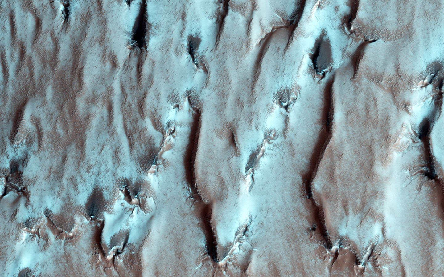 This image from NASA's Mars Reconnaissance Orbiter shows the edge of the Martian South Polar layered deposit. The stack of fine layering is highlighted by the rays of the polar sun.