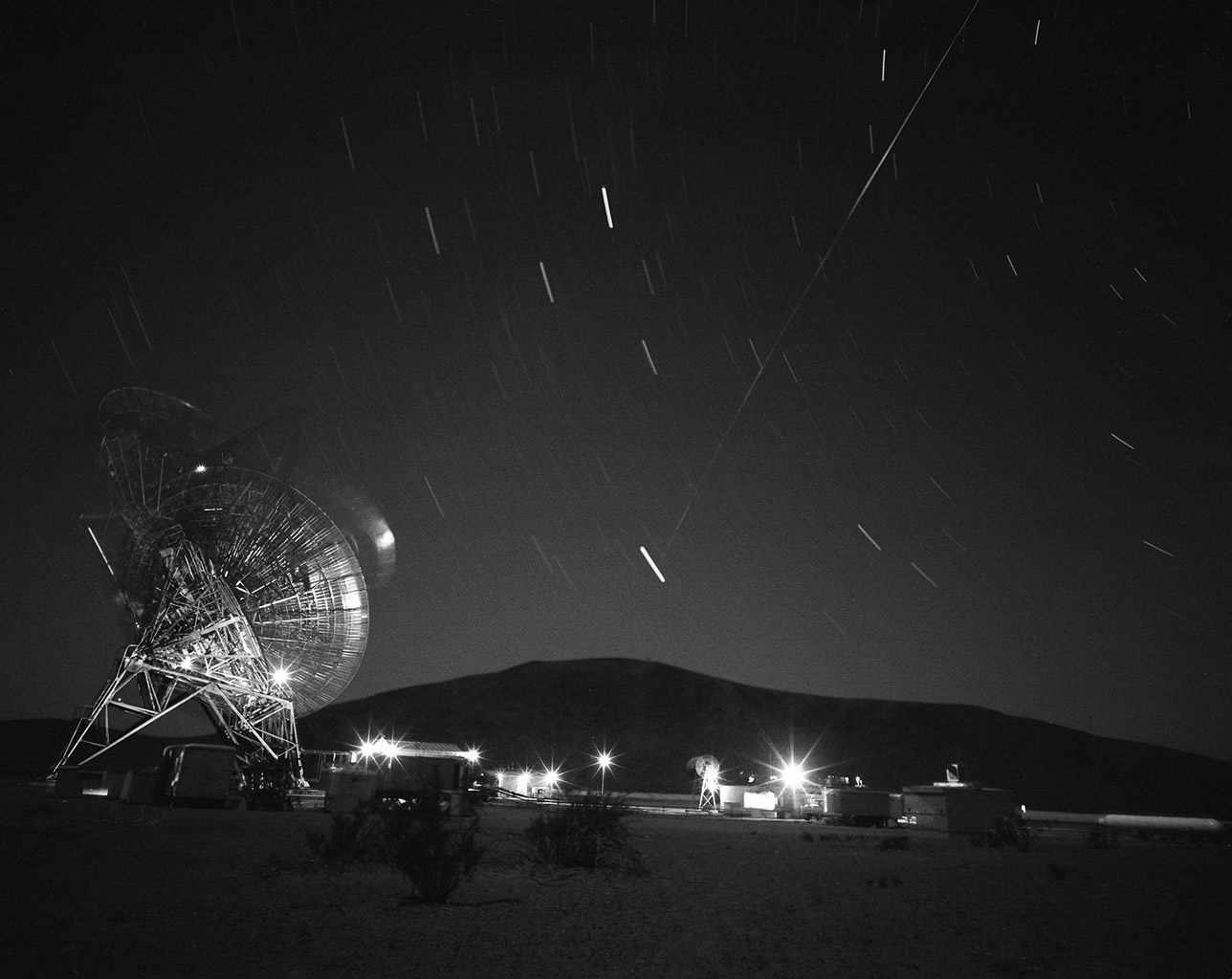 This archival photograph shows the first pass of Echo 1, America's first communications satellite, over the Goldstone Tracking Station managed by NASA's Jet Propulsion Laboratory, in Pasadena, California, in the early morning of Aug. 12, 1960.