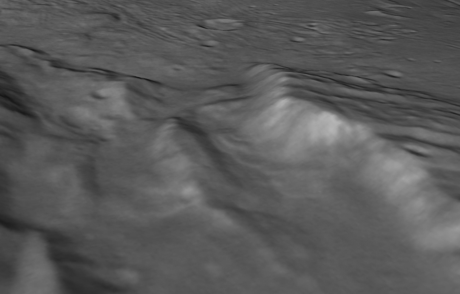 Scientists from NASA's New Horizons mission have spotted signs of long run-out landslides on Pluto's largest moon, Charon. This perspective view is of Charon's informally named Serenity Chasma.