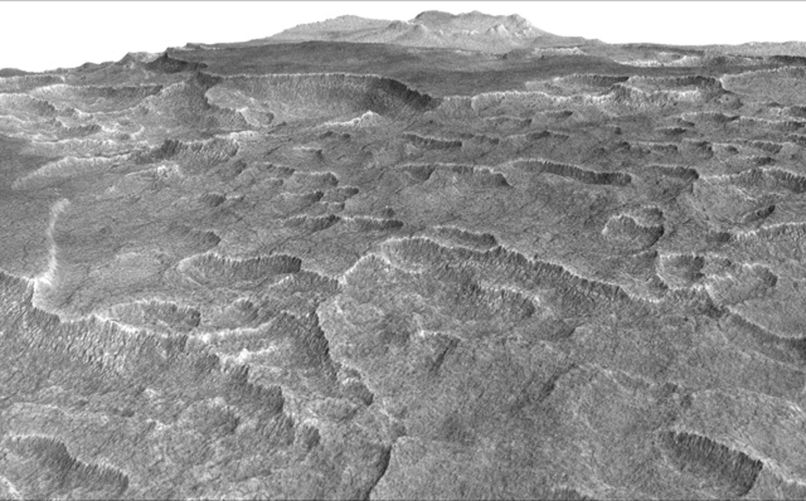 This vertically exaggerated view shows scalloped depressions in Mars' Utopia Planitia region, prompting the use of ground-penetrating radar aboard NASA's Mars Reconnaissance Orbiter to check for underground ice.