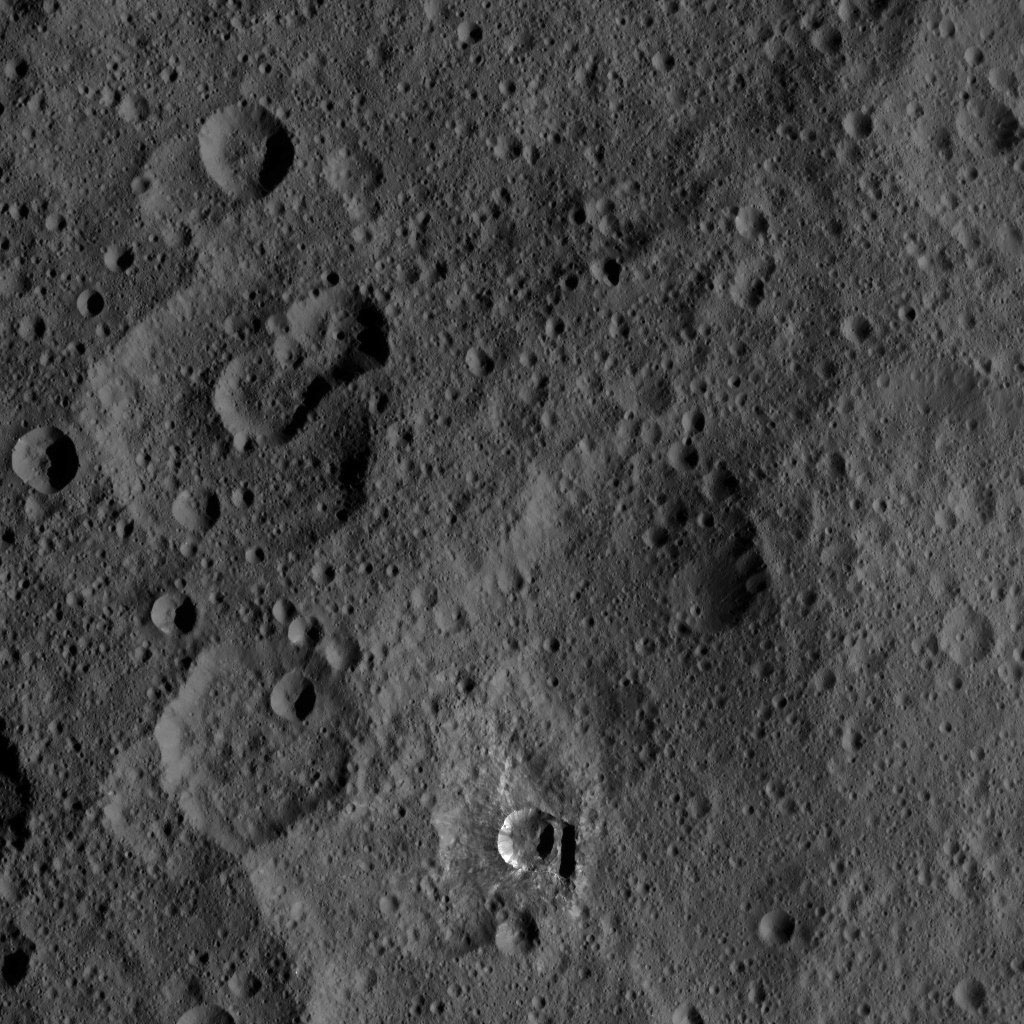 The small, bright crater Oxo on Ceres is featured in this image from NASA's Dawn spacecraft taken on Oct. 17, 2016. Oxo (6 miles, 10 kilometers in diameter) is located at mid-latitudes on Ceres and likely has water ice.