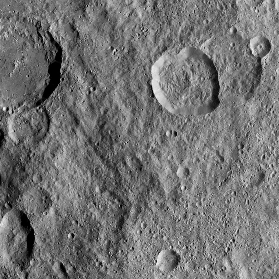 This image, taken by NASA's Dawn spacecraft, shows Azacca Crater (31 miles, 50 kilometers wide) at top left, with its prominent set of north-south trending fractures. Dawn took this image on Oct. 17, 2016.