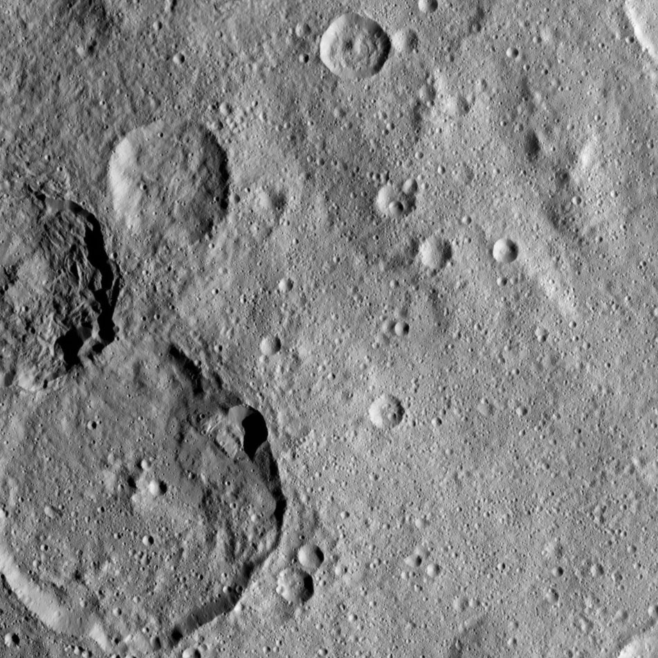 This view, taken on Oct. 22, 2016, from NASA's Dawn spacecraft shows the craters Kondos and Jarimba on Ceres. Jarimba is the largest crater, located at left. Above Jarimba, on the left-hand edge of the image, is Kondos.