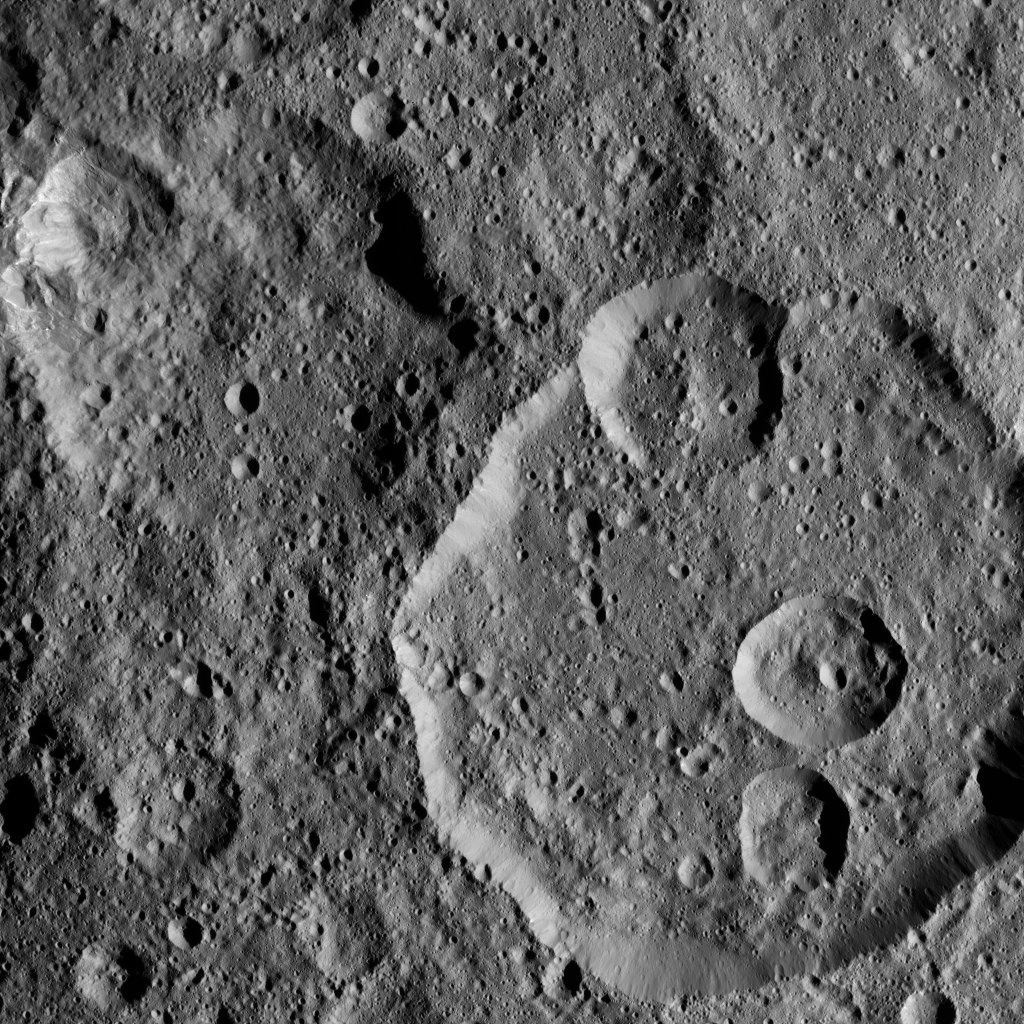 This view, taken on Oct. 26, 2016, from NASA's Dawn spacecraft shows Meanderi Crater on Ceres, seen at lower right. Meanderi hosts several medium-sized craters within its walls.