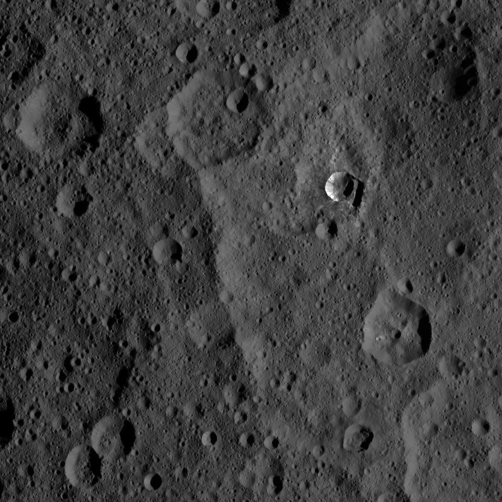The 6-mile-wide (10-kilometer-wide) Oxo Crater stands out on the dark landscape of Ceres in this view from NASA's Dawn spacecraft.
