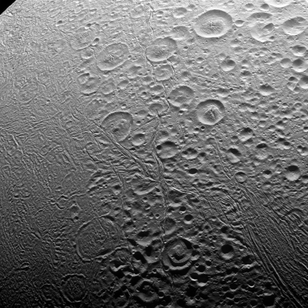The north polar area of Enceladus, seen in this image captured by NASA's Cassini spacecraft, is heavily cratered, an indication that the surface has not been renewed since quite long ago. But the south polar region shows signs of intense geologic activity