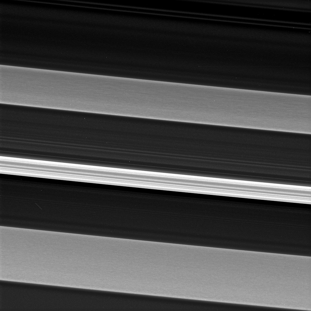 In this image from NASA's Cassini spacecraft, a bright and narrow ringlet located toward the outer edge of the C ring is flanked by two broader features called plateaus.