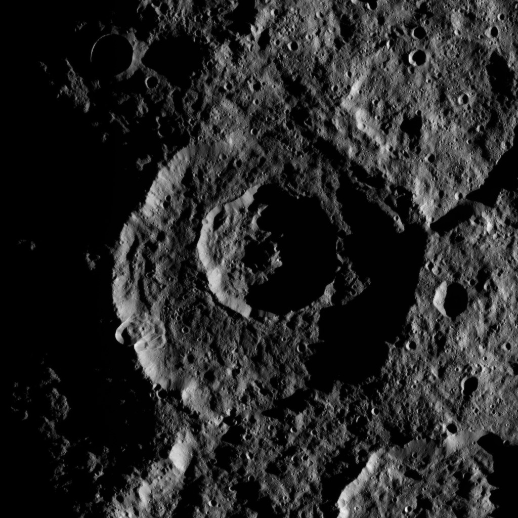 On Oct. 24, 2016, NASA's Dawn spacecraft captured the low angle of illumination bringing this pair of nested craters near Ceres' south pole into sharp relief.