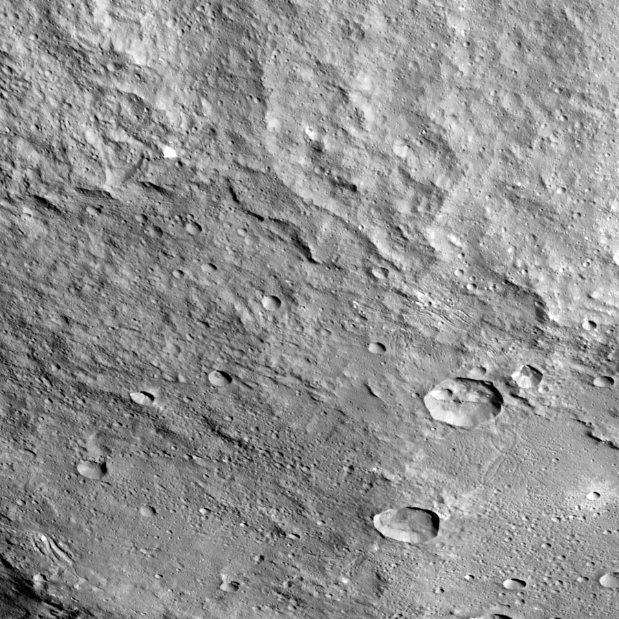 This view of the northern portion of Yalode is one of many images NASA's Dawn spacecraft has taken. The large impact that formed the crater likely involved a lot of heat, explaining the relatively smooth crater floor punctuated by smaller craters.