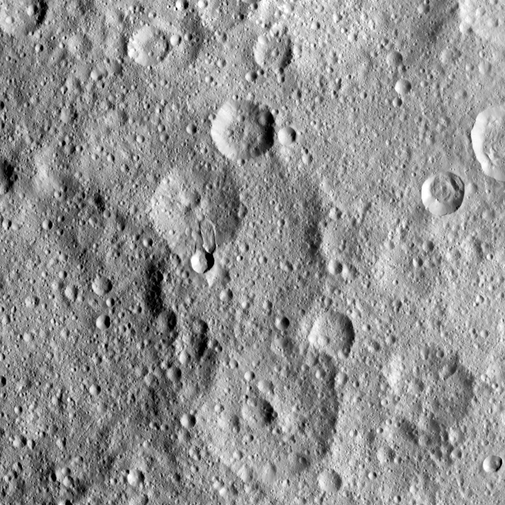 NASA's Dawn spacecraft took this image of Hakumyi Crater on Ceres, visible left of center. Evidence for organics was also found at the 4-mile (6.5 kilometer) wide fresh crater on the southern rim of Hakumyi.