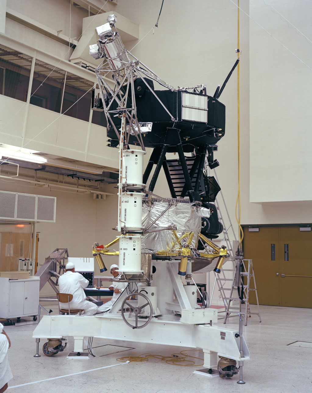 This photo shows the Voyager Proof Test Model undergoing a mechanical preparation and weight center of gravity test at NASA's Jet Propulsion Laboratory, Pasadena, California, on January 12, 1977.