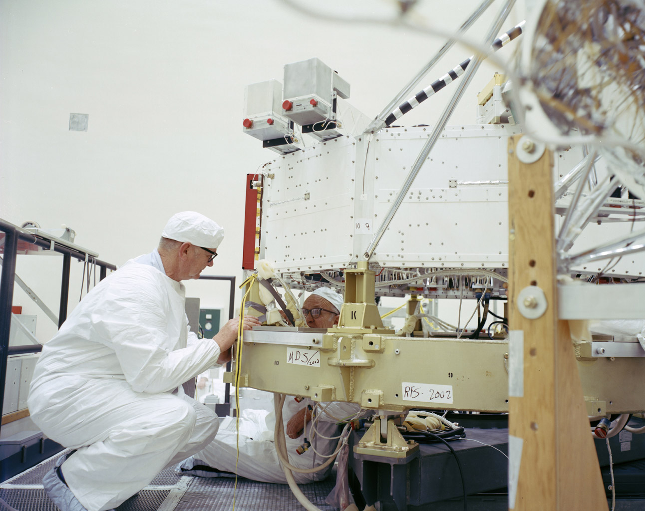 This archival photo shows engineers at NASA's Jet Propulsion Laboratory working on the 10-sided central structure, or 'bus,' of the Voyager 2 spacecraft on February 24,1977.