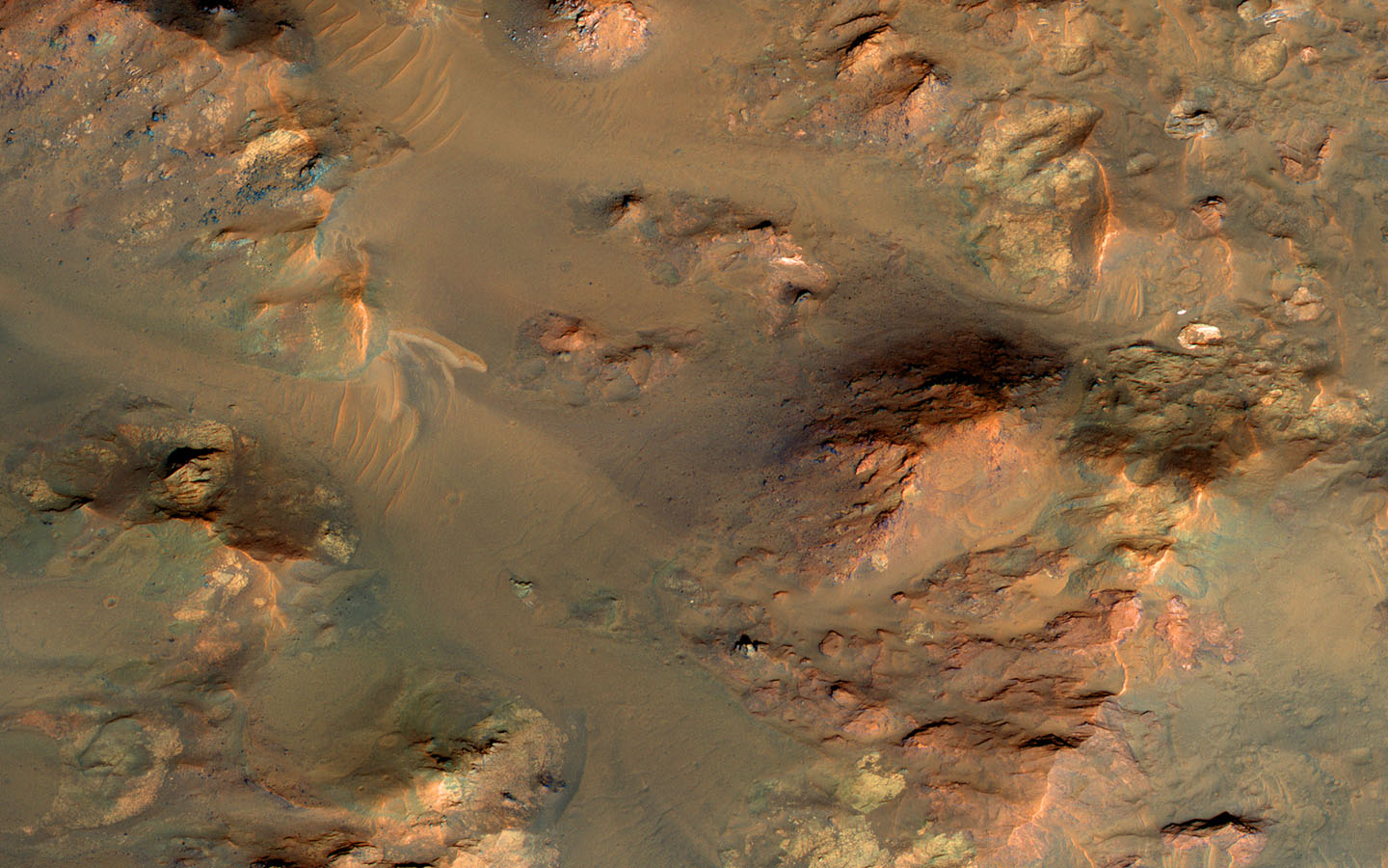 This image from NASA's Mars Reconnaissance Orbiter shows part of the central uplifted region of an impact crater more than 50 kilometers wide.