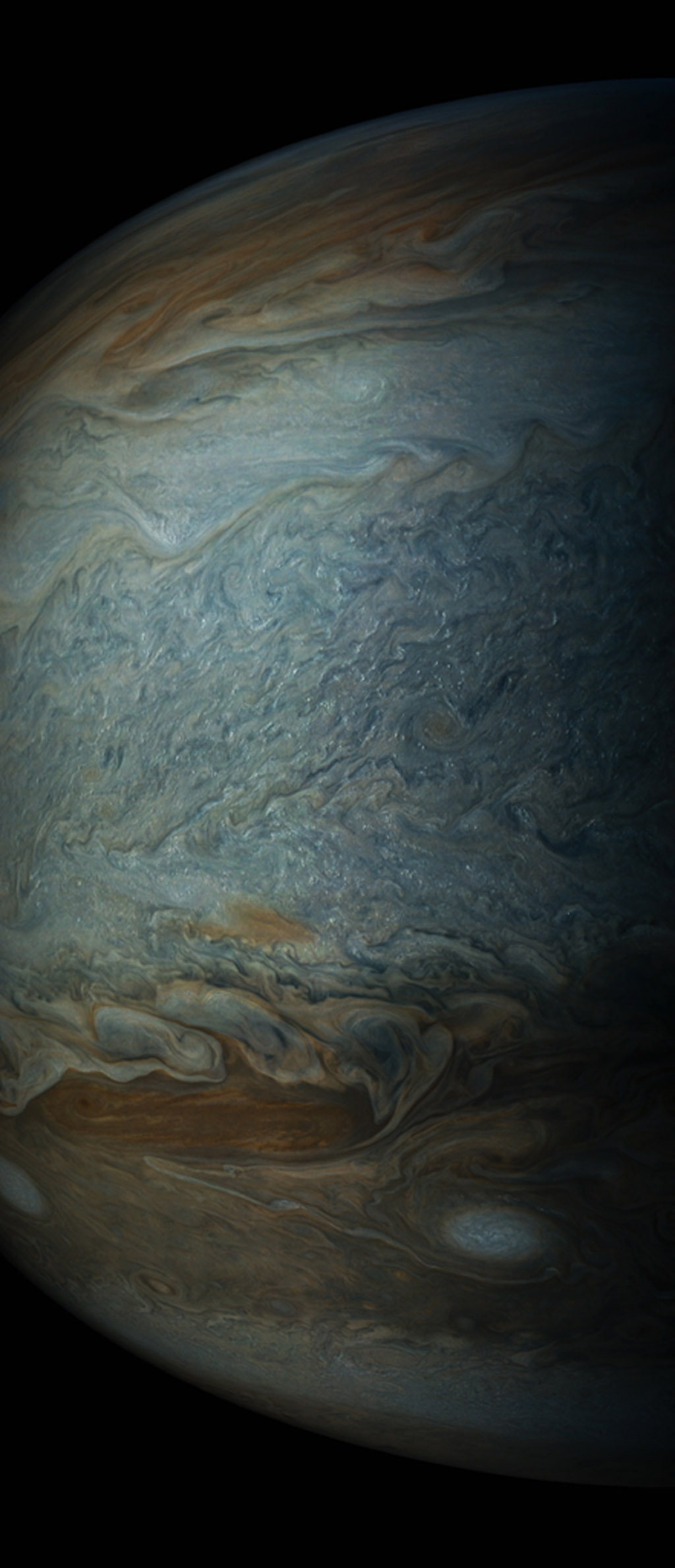 Small bright clouds dot Jupiter's entire south tropical zone in this image acquired by JunoCam on NASA's Juno spacecraft on May 19, 2017.