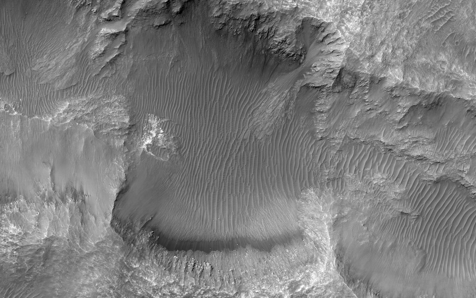This image from NASA's Mars Reconnaissance Orbiter shows an elongated depression from three merged craters.