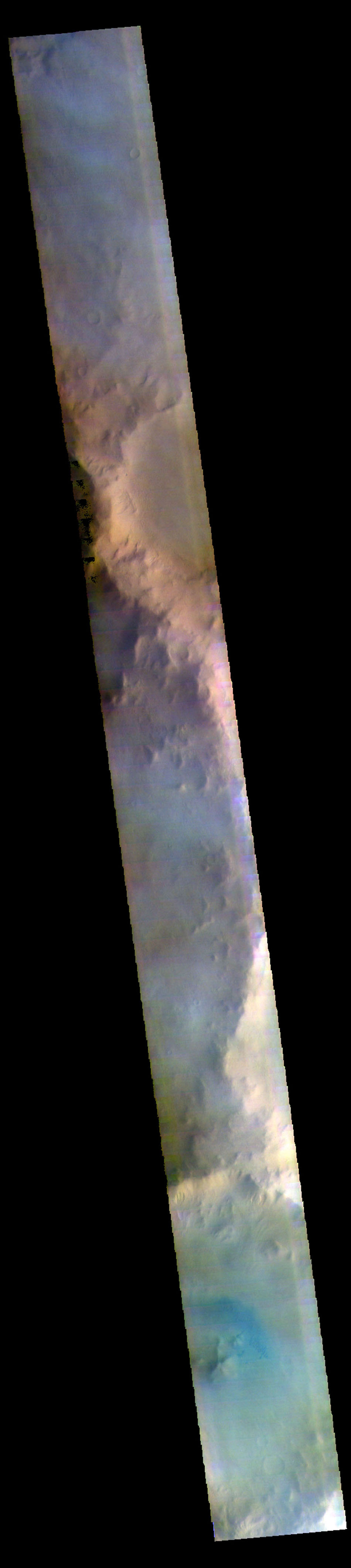 The THEMIS camera contains 5 filters. Data from different filters can be combined in many ways to create a false color image. This image from NASA's 2001 Mars Odyssey spacecraft shows part of the plains and craters of Terra Sirenum.