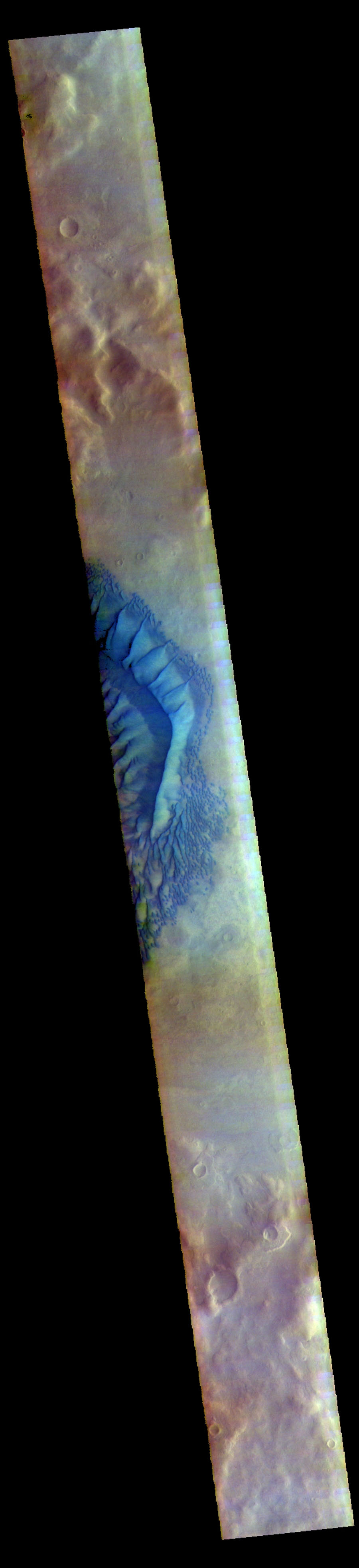 The THEMIS camera contains 5 filters. Data from different filters can be combined in many ways to create a false color image. This image from NASA's 2001 Mars Odyssey spacecraft shows part of Russell Crater in Noachis Terra.