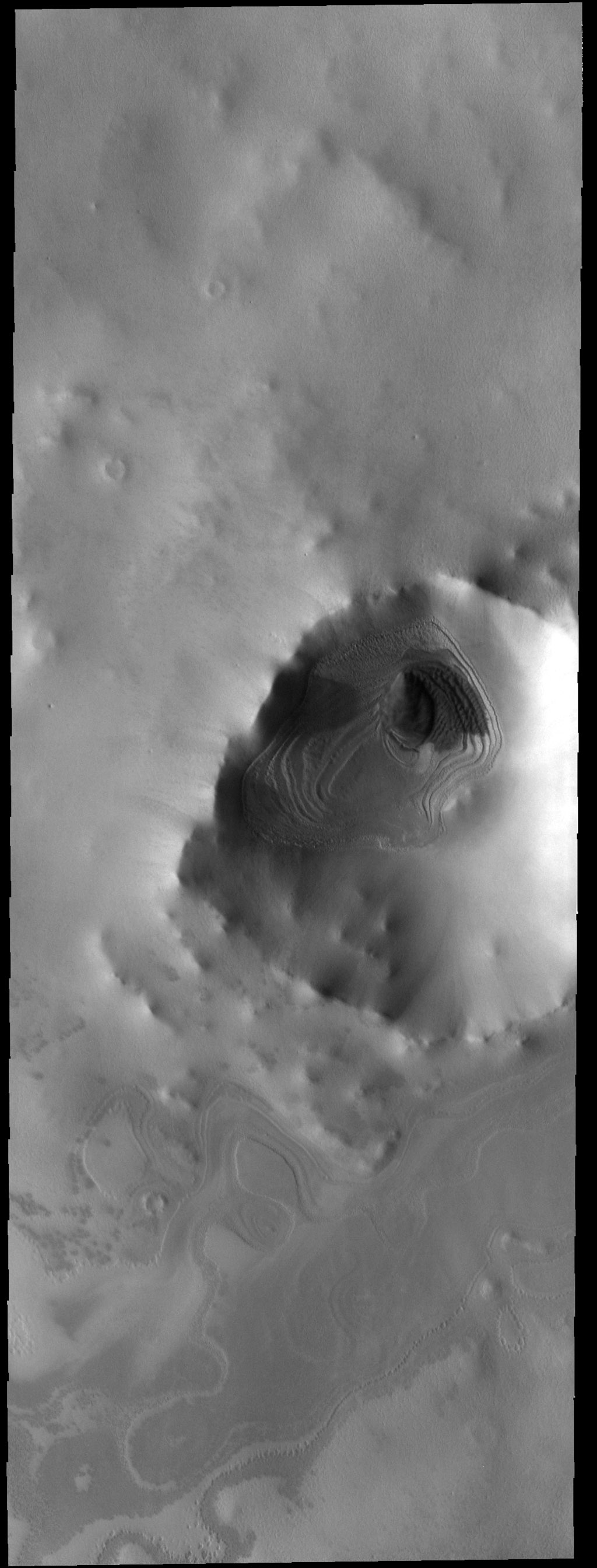 This image captured by NASA's 2001 Mars Odyssey spacecraft is of an unnamed crater near the south pole. This image was taken in the late afternoon, and the low sun angle created shadows cast by the crater rim.