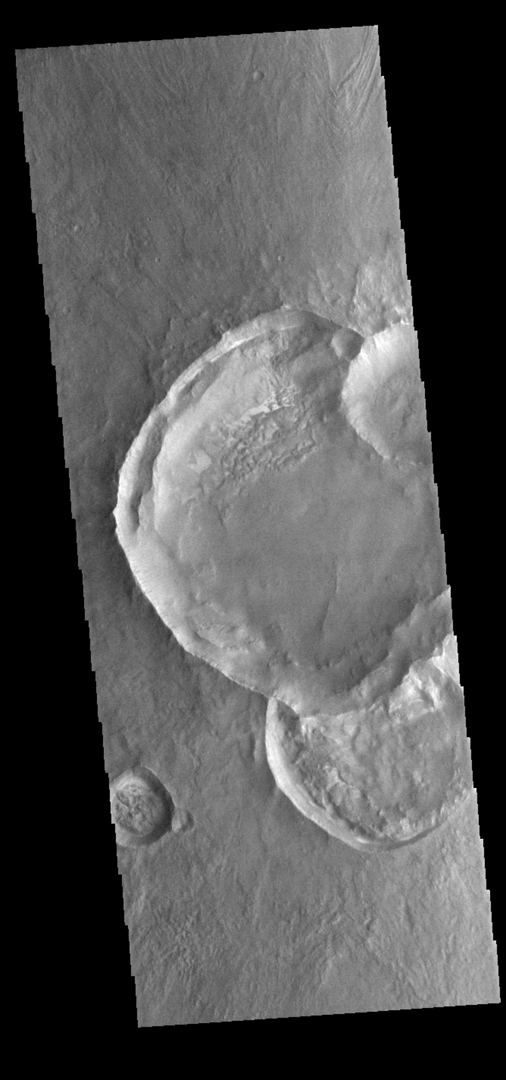 This image from NASA's 2001 Mars Odyssey spacecraft is of a group of craters in Solis Planum. Because three of the craters are overlapping it is possible to determine the order in which those three were created.