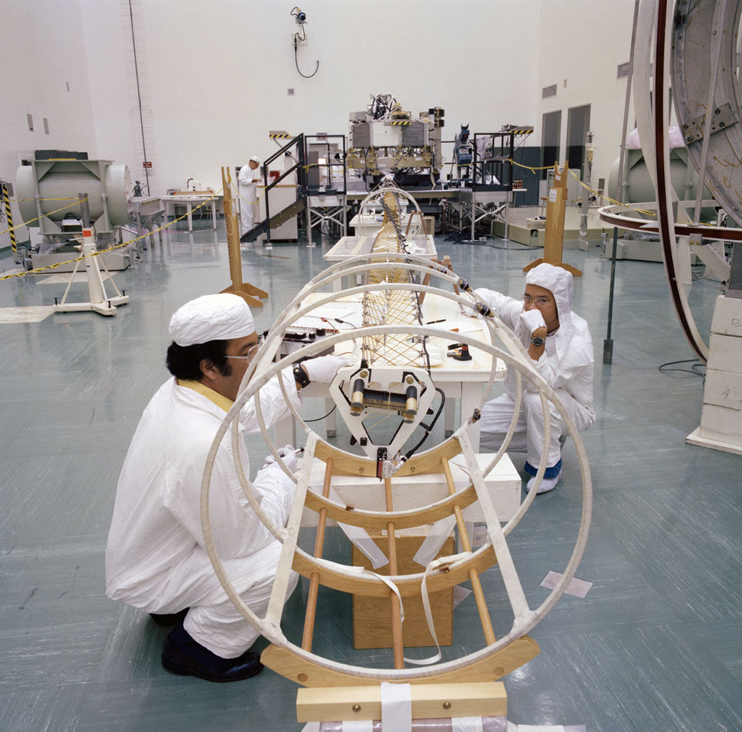 This archival photo shows engineers working with the deployed magnetometer boom of one of NASA's Voyager spacecraft in Florida on June 17, 1977.