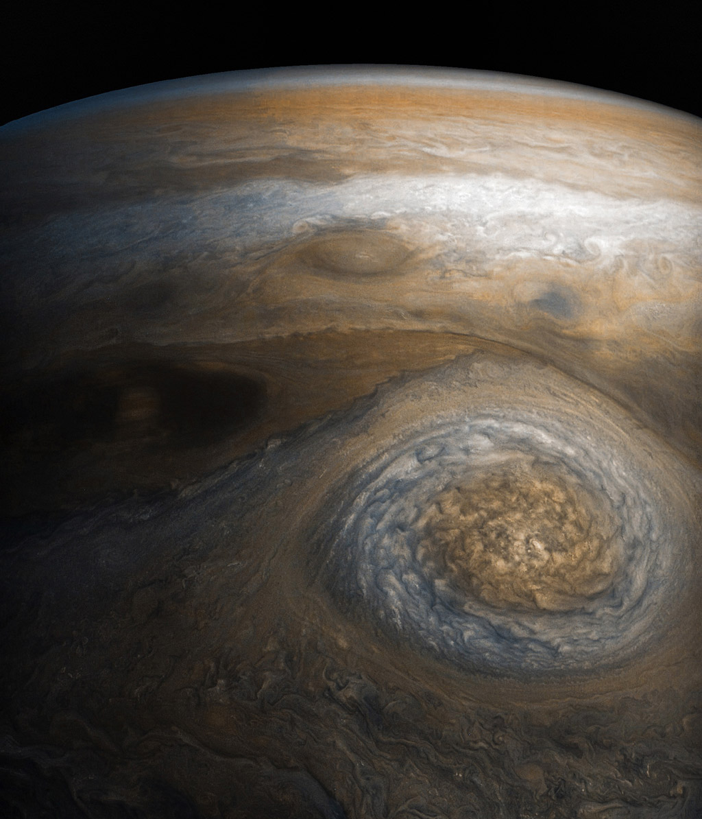 A dynamic storm at the southern edge of Jupiter's northern polar region dominates this Jovian cloudscape, courtesy of NASA's Juno spacecraft.