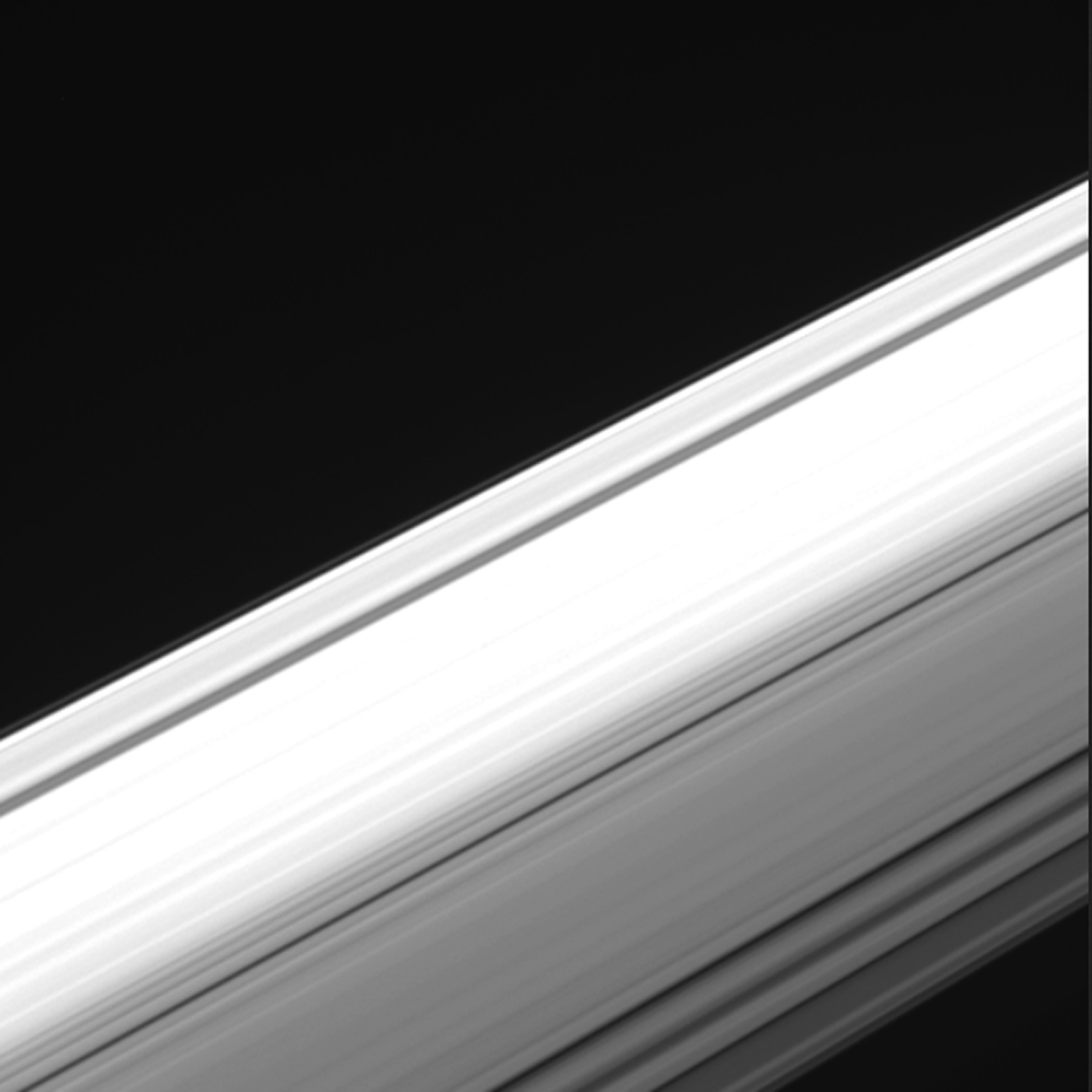 This frame from a movie from NASA's Cassini spacecraft offers a unique perspective on Saturn's ring system. Cassini from within the gap between the planet and its rings, looking outward.