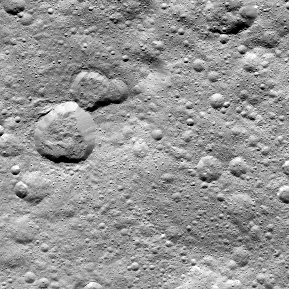 This image from NASA's Dawn spacecraft shows a group of craters, left of center, that resembles a rubber duck. The 'head' is dubbed Halki Crater, the 'Body' Telepinu Crater, the 'beak' crater is unnamed.