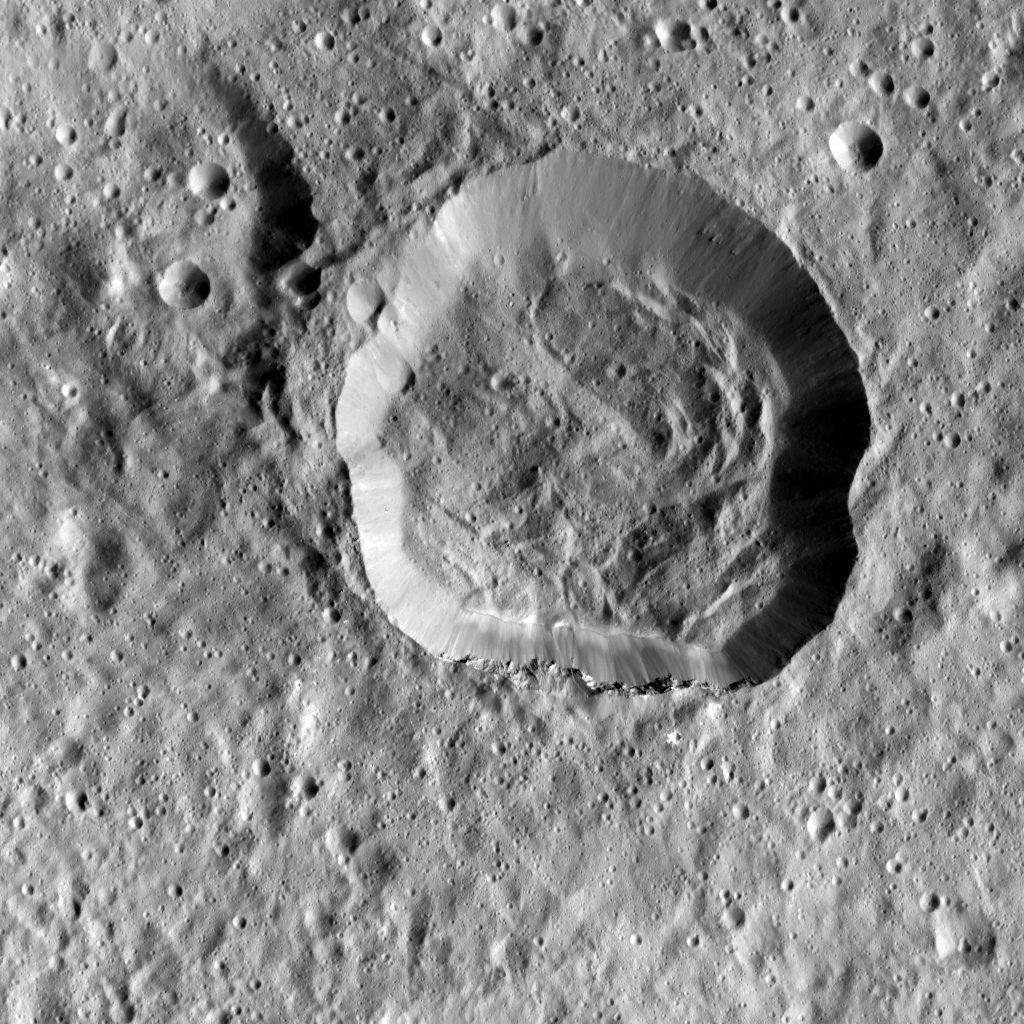 This image taken by NASA's Dawn spacecraft shows Emesh, a crater on Ceres. Emesh, named after the Sumerian god of vegetation and agriculture, is located at the edge of the Vendimia Planitia.