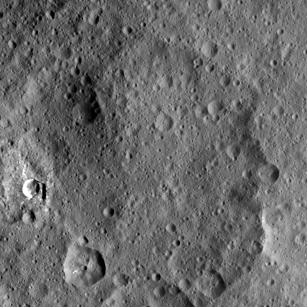 This image taken by NASA's Dawn spacecraft shows Duginavi Crater, a large crater on Ceres. Duginavi hosts the small Oxo Crater, recognizable by its bright rim and ejecta.