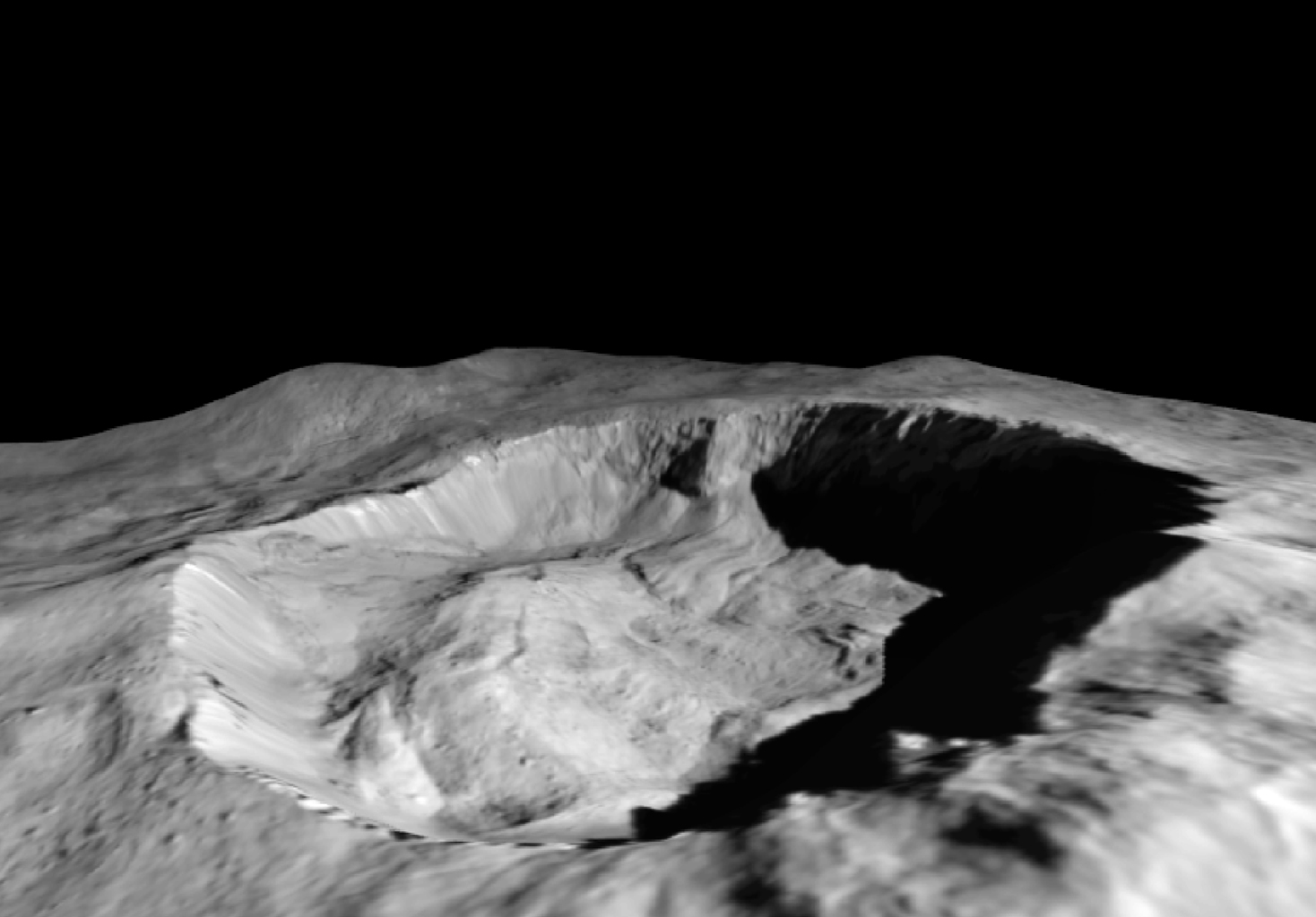 This view from NASA's Dawn mission shows where ice has been detected in the northern wall of Ceres' Juling Crater, which is in almost permanent shadow.