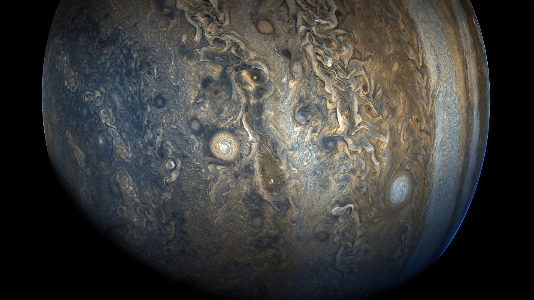 Jupiter's southern hemisphere in beautiful detail is captured in this image taken by NASA's Juno spacecraft. The color-enhanced view captures one of the white ovals in the 'String of Pearls,' one of eight massive rotating storms.