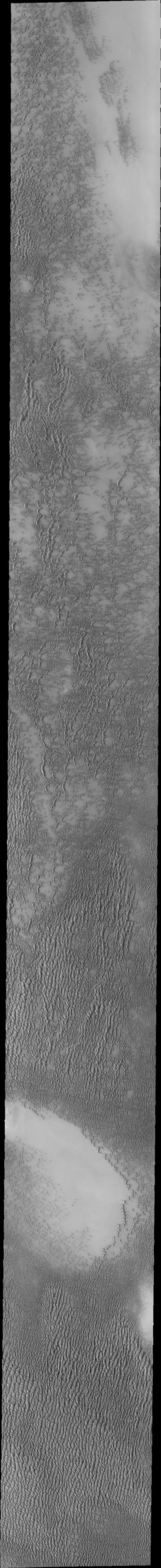 Siton Undae is a large dune field located in the northern plains near Escorial Crater. This image from NASA's 2001 Mars Odyssey spacecraft shows part of a dune field just west of Escorial Crater (just off the top of image).