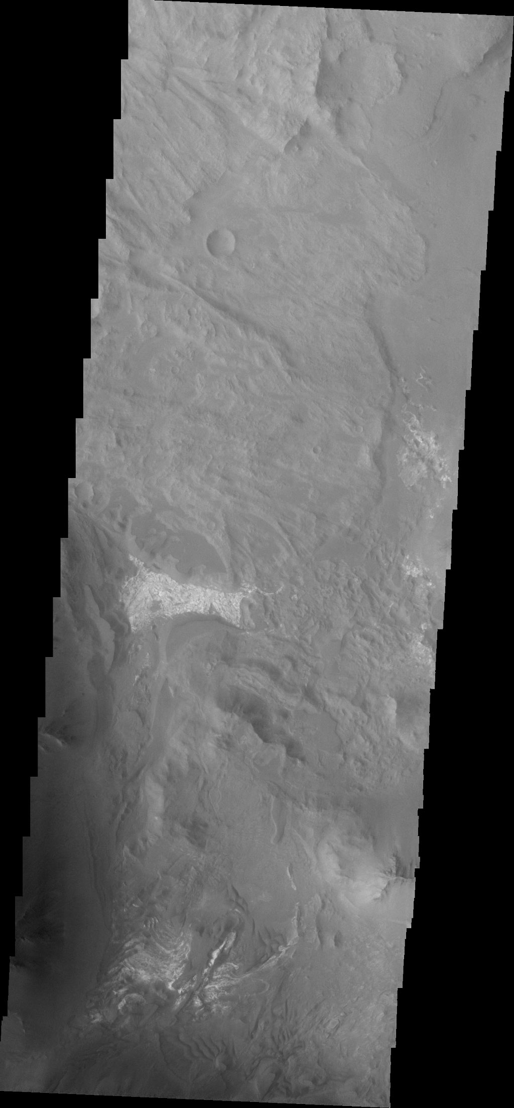 Coprates Chasma is one of the numerous canyons that make up Valles Marineris. This image captured by NASA's 2001 Mars Odyssey spacecraft is located in eastern Coprates Chasma.