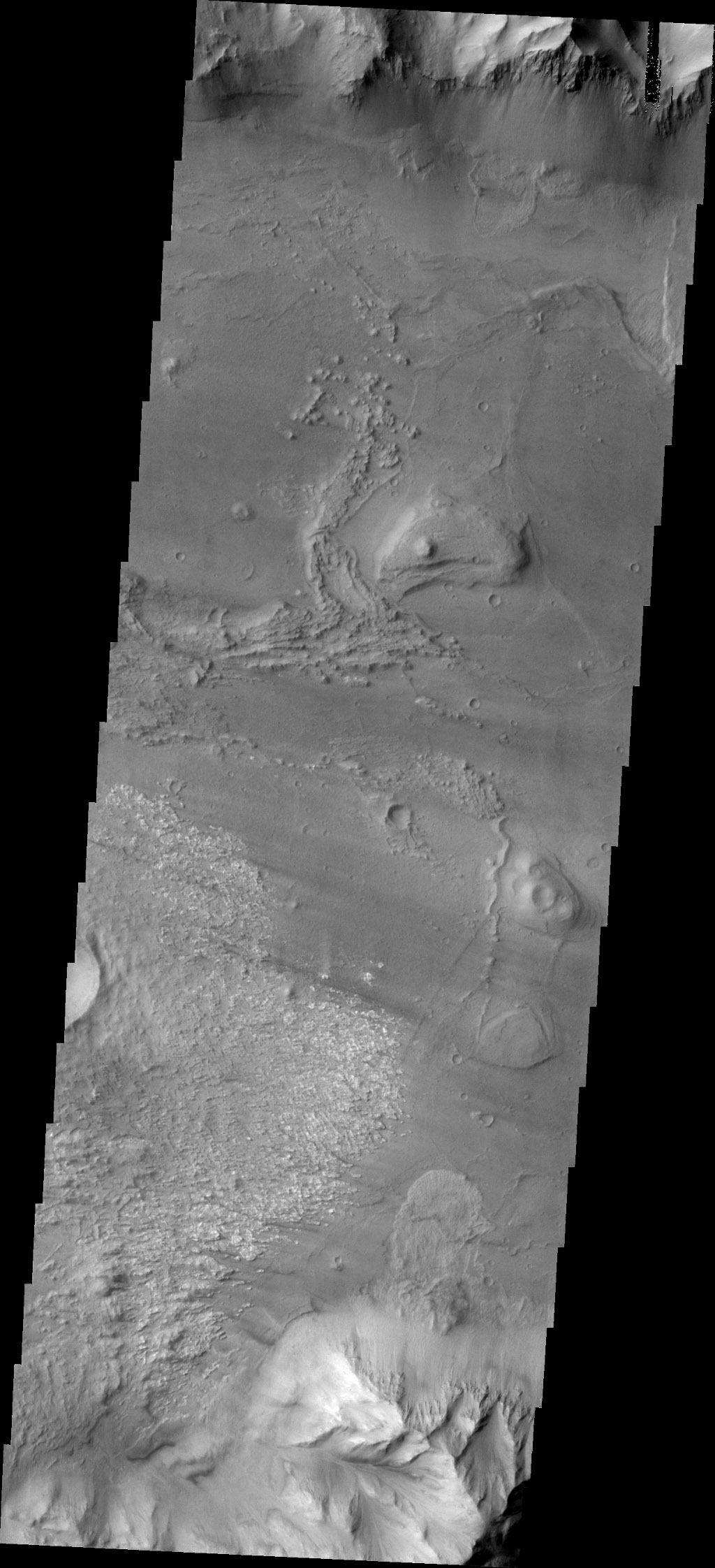 Coprates Chasma is one of the numerous canyons that make up Valles Marineris. This image from NASA's 2001 Mars Odyssey spacecraft is located in central Coprates Chasma. In this view, there is a landslide deposit at the bottom of the image.