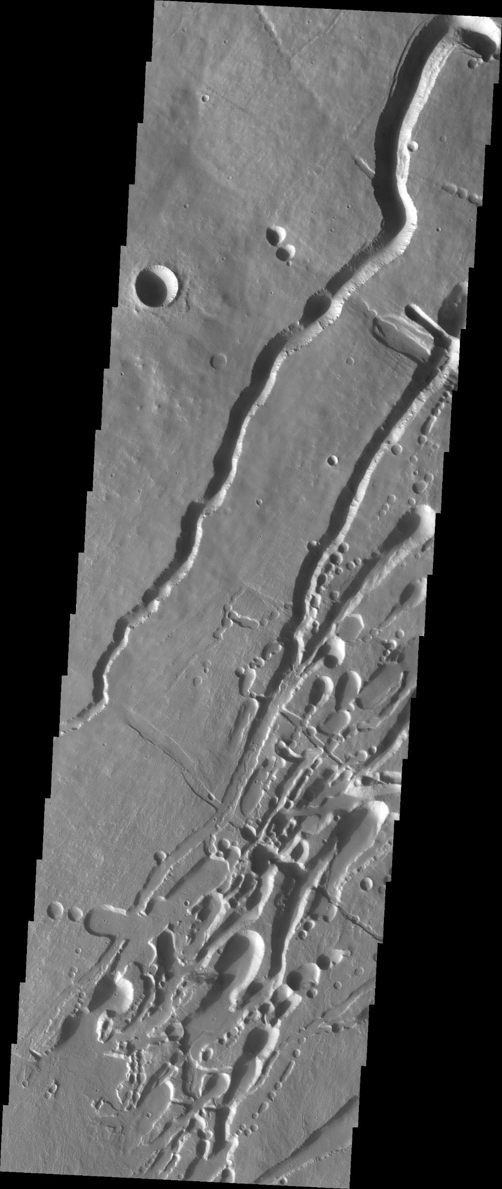 This image from NASA's 2001 Mars Odyssey spacecraft shows part of the southern flank of Pavonis Mons. Pavonis Mons is one of the three aligned Tharsis Volcanoes.