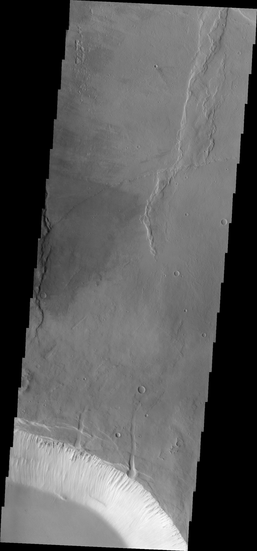 This image from NASA's 2001 Mars Odyssey spacecraft shows part of the two summit calderas of Pavonis Mons. The surface in the majority of the image is the floor of the larger caldera.