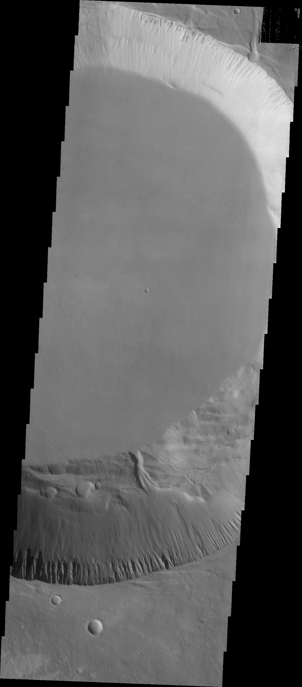 This image from NASA's 2001 Mars Odyssey spacecraft shows part of the smaller summit caldera of Pavonis Mons. This caldera is approximately 5km deep. Pavonis Mons is one of the three aligned Tharsis Volcanoes.
