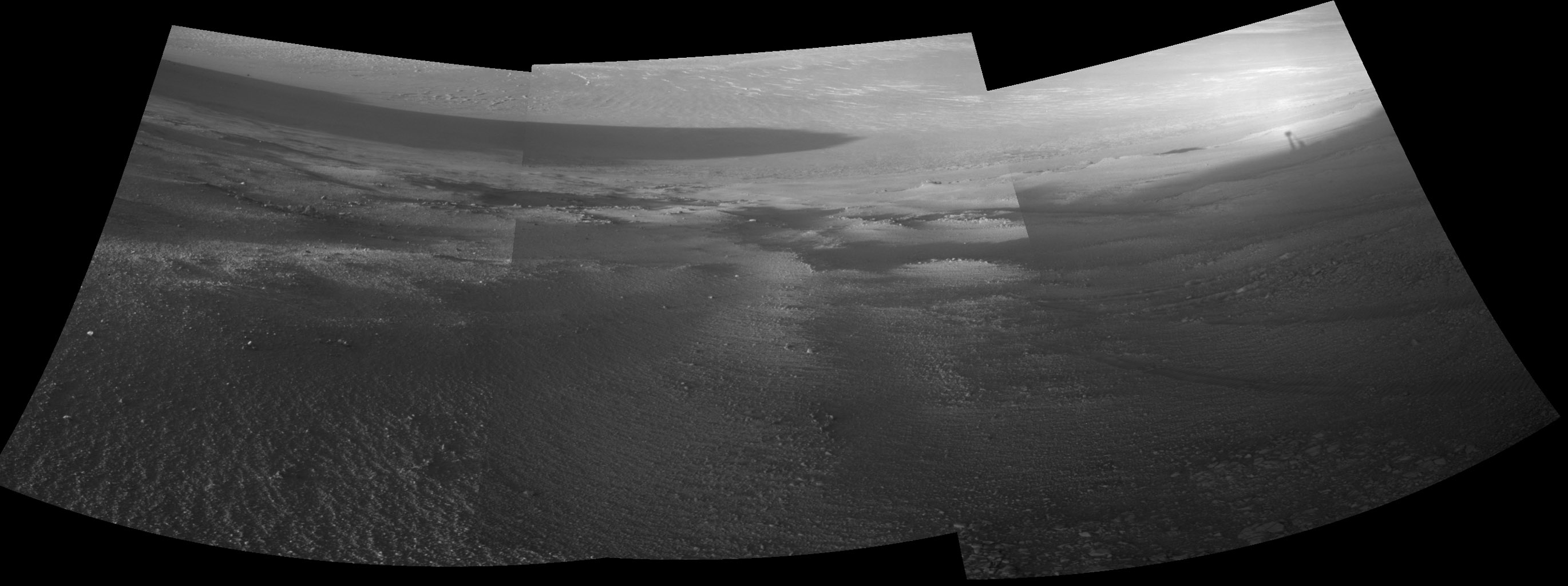 Late-afternoon shadows include one cast by the rover itself in this look toward the floor of Endeavour Crater by NASA's Mars Exploration Rover Opportunity. The rover recorded this scene on Nov. 11, 2017.