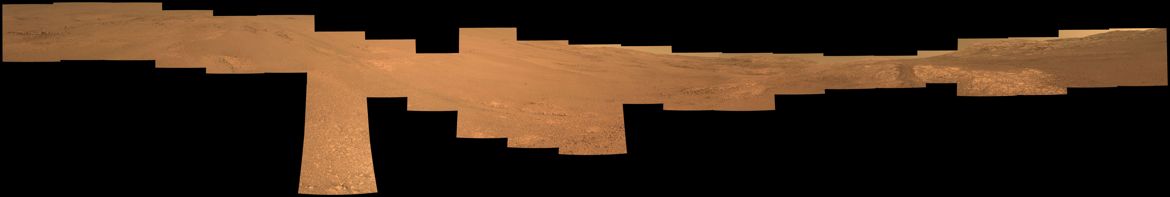 This view from within 'Perseverance Valley,' on the inner slope of the western rim of Endurance Crater on Mars, includes wheel tracks from NASA's Opportunity rover's descent of the valley.