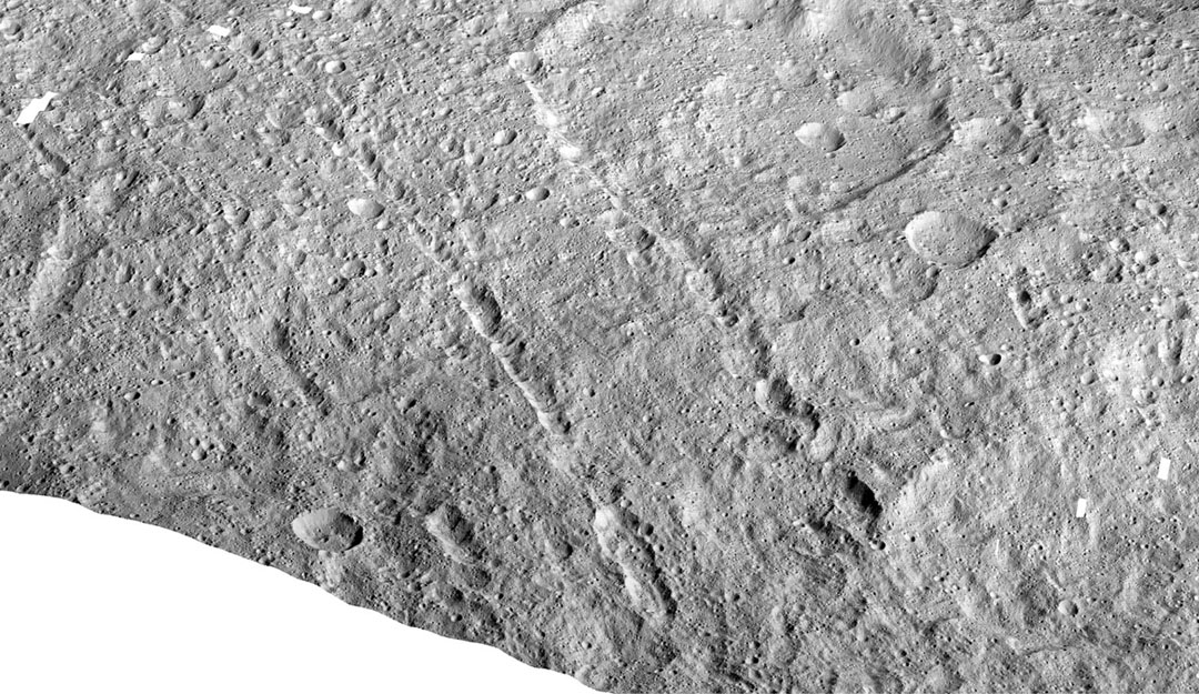 This image made with data from NASA's Dawn spacecraft shows pit chains on dwarf planet Ceres called Samhain Catenae.