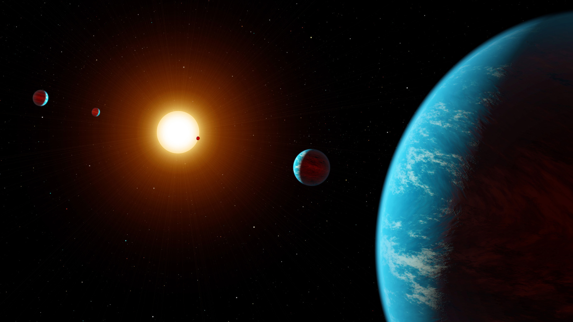 This artist concept shows the K2-138 system, the first multi-planet system