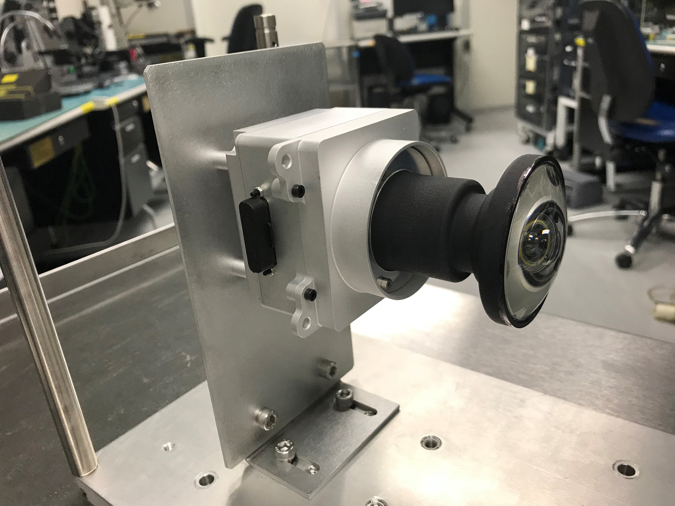 This image shows one of the enhanced engineering cameras with a prototype lens for the Hazcams, which will watch for obstacles encountered by NASA's Mars 2020 rover.