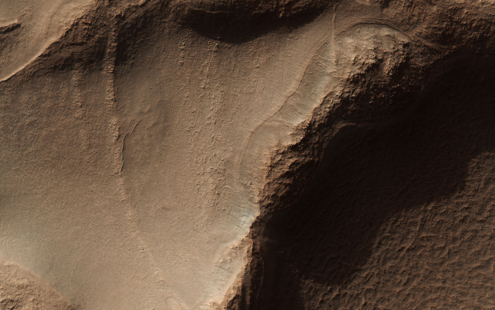 This image from NASA's Mars Reconnaissance Orbiter (MRO) targets a portion of a group of honeycomb-textured landforms in northwestern Hellas Planitia, part of one of the largest and most ancient impact basins on Mars.