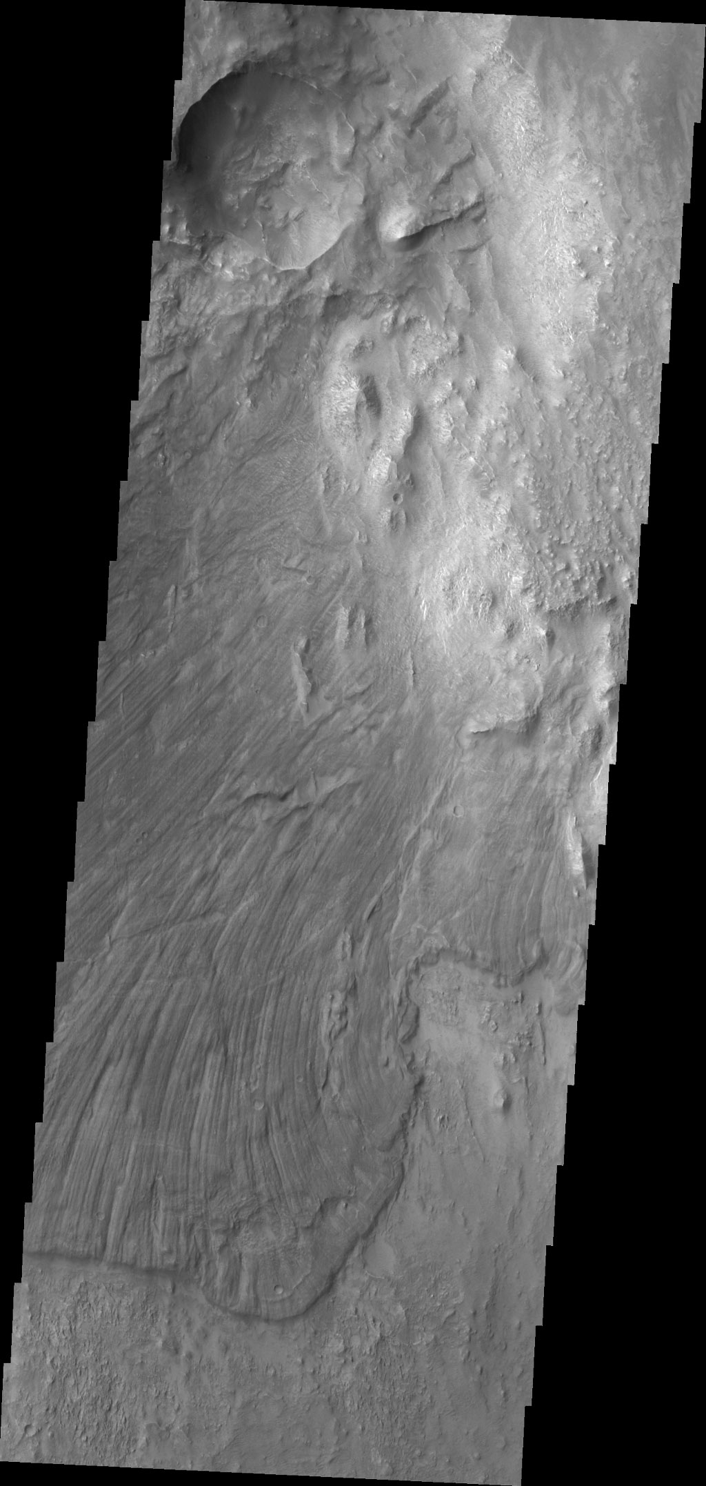 Melas Chasma is part of the largest canyon system on Mars, Valles Marineris. This image captured by NASA's 2001 Mars Odyssey spacecraft is located along the northern side of the chasma.
