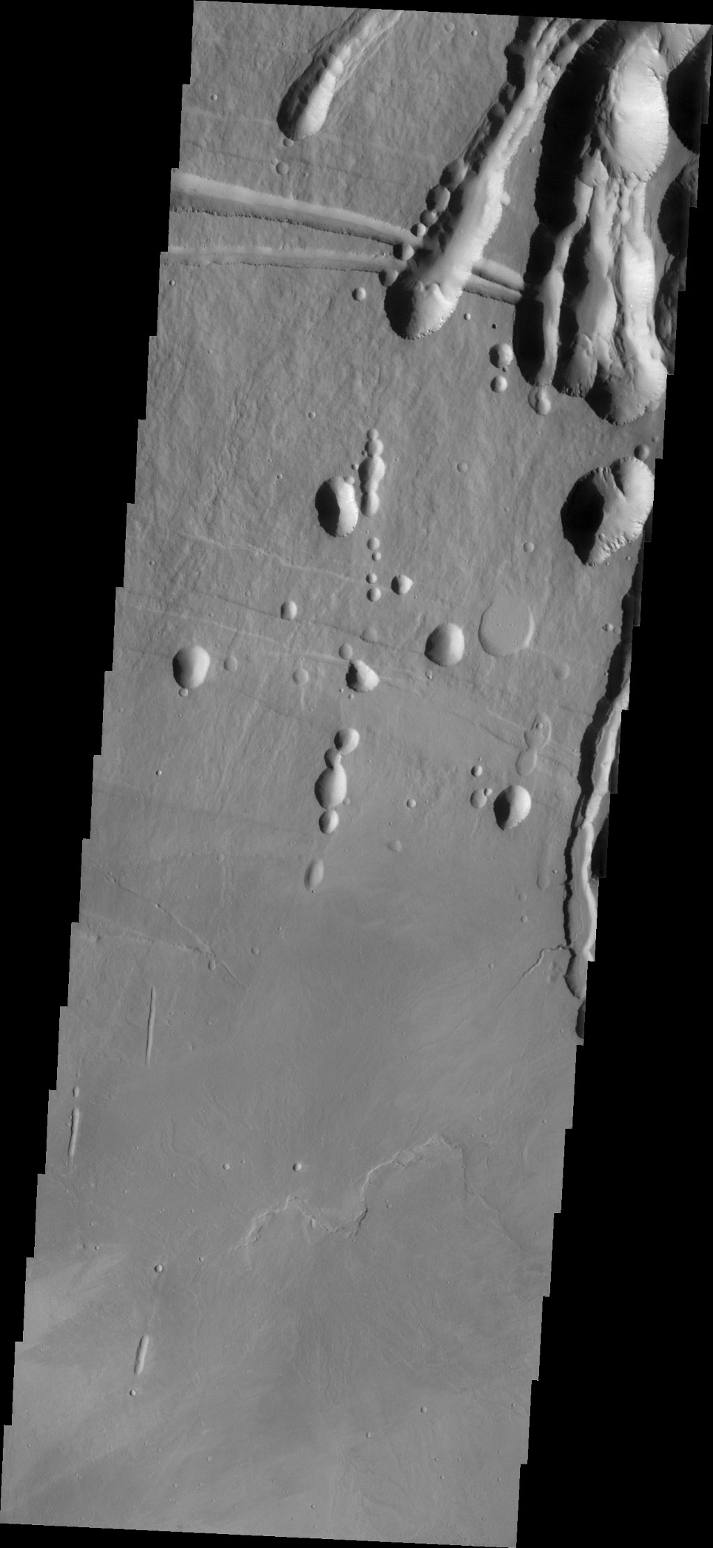 The three large aligned Tharsis volcanoes are Arsia Mons, Pavonis Mons and Ascreaus Mons (from south to north). This image from NASA's 2001 Mars Odyssey spacecraft shows part of the northeastern flank of Arsia Mons at the summit caldera.