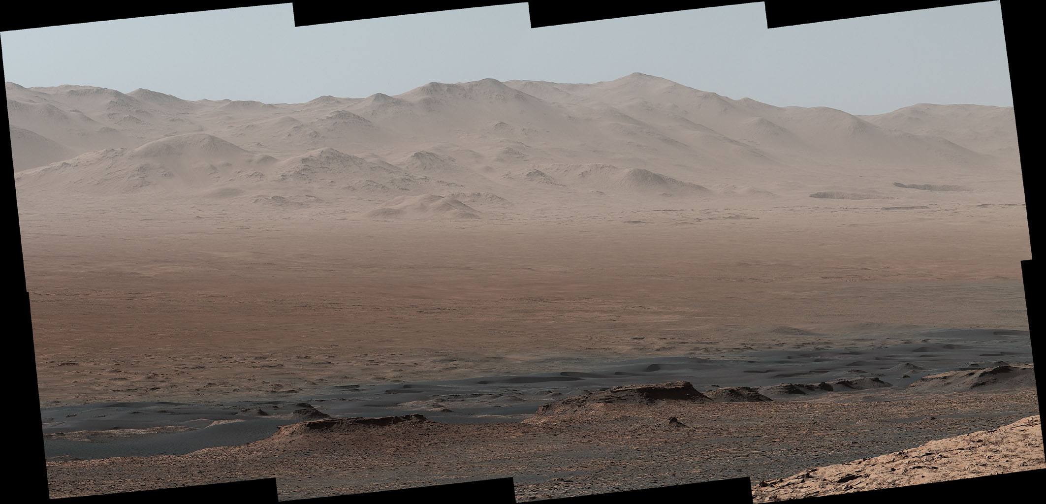A vantage point on 'Vera Rubin Ridge' provided NASA's Curiosity Mars rover this detailed look back over the area where it began its mission inside Gale Crater, plus more-distant features of the crater.
