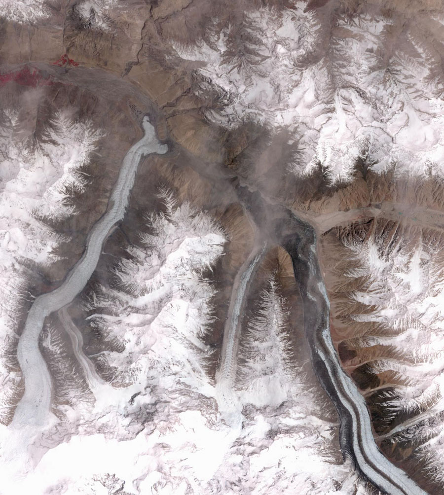 This image from NASA's Terra spacecraft shows the Khurdopin Glacier in Pakistan. A large lake has formed in the Shimshal River, where the glacier has formed a dam.